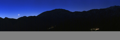 Crescent Moon at Dawn over the Alborz Mountains and Villages in the Haraz Valley of Iran Photographic Print by Babak Tafreshi