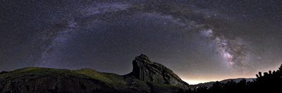 The Arc of the Milky Way Above the Rock That Holds Ruins of the Mountain Fortress of Alamut Photographic Print by Babak Tafreshi