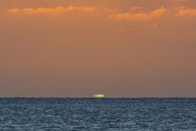 Green Flash after Sunset from Kamalo Wharf, Molokai, Hawaii Photographic Print by Richard Cooke III