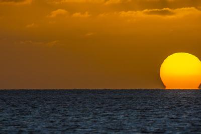 Sun Setting into the Pacific Ocean from Kamalo Wharf, Molokai, Hawaii Photographic Print by Richard Cooke III