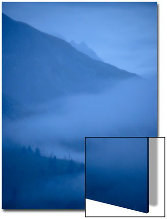 Early Morning Fog Wafting into a Valley in Glacier Bay National Park Print by Michael Melford