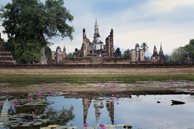A Sukhothai Era Buddha at Wat Mahathat, Sukhothai Historical Park, Thailand Photographic Print by Alex Robinson