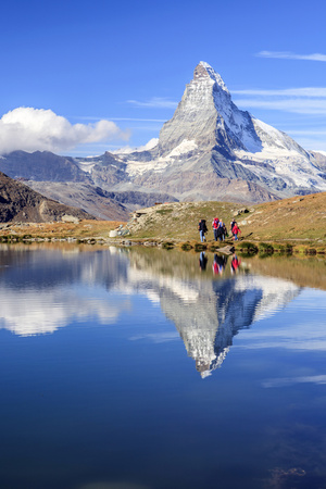 Hikers Walking on the Path Beside the Stellisee with the Matterhorn Reflected Photographic Print by Roberto Moiola