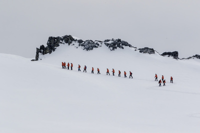 Lindblad Expeditions Guests from the National Geographic Explorer Hiking at Orne Harbor, Antarctica Photographic Print by Michael Nolan