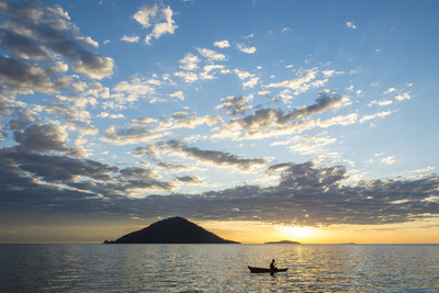 Silhouette of a Man in a Little Fishing Boat at Sunset, Cape Malcear, Lake Malawi, Malawi, Africa Photographic Print by Michael Runkel