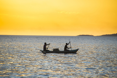 Backlight of Fishermen in a Little Fishing Boat at Sunset Photographic Print by Michael Runkel