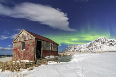 Northern Lights (Aurora Borealis) over an Abandoned Log Cabin Surrounded by Snow and Ice Photographic Print by Roberto Moiola