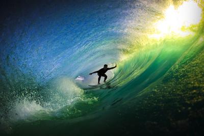Surfer in Tube Prints by  Lantern Press