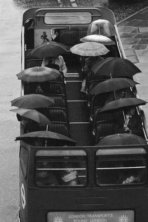Tourists under Umbrellas on Open Top Bus, 1976 Photographic Print by Kent Gavin