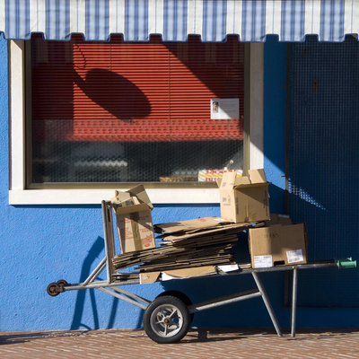 Il Carro. Handcart Laden with Cardboard Boxes Photographic Print by Mike Burton