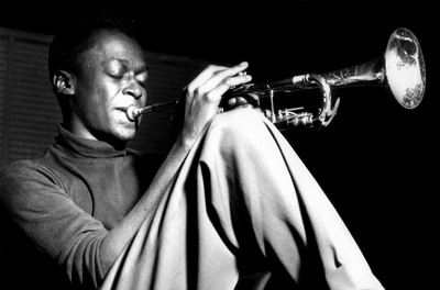 Miles Davis- Sitting With Trumpet Posters