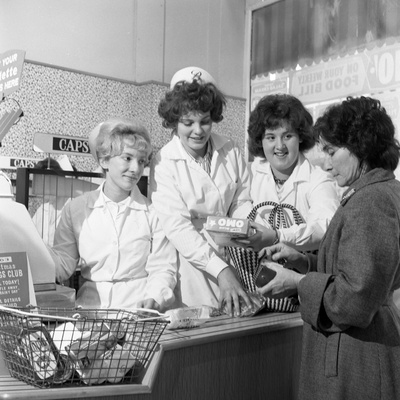 Checkout Girls at a Supermarket Opening, Broughs Ltd, Thurnscoe, South Yorkshire, 1963 Photographic Print by Michael Walters