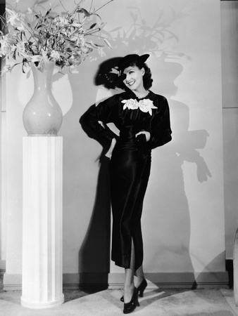 Jean Parker, Modeling a 'Collegienne Frock' of Black Satin with a Split Skirt, Ca. Mid-1930s Photo