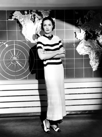 Gail Patrick, Modeling a Cruise Ensemble of Brown and White Crepe, with a Wooden Anchor Brooch Photo