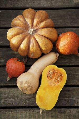Pumpkin, Butternut- and Hokkaido Squashes on Wooden Background Photographic Print by  Fotos mit Geschmack
