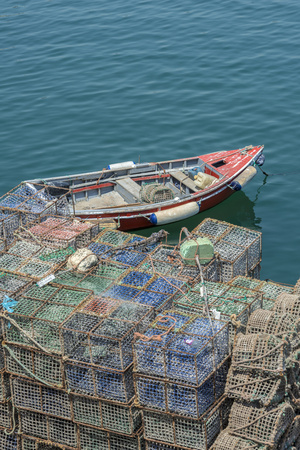 Portugal, Cascais, Lobster Traps and Fishing Boat in Harbor Photographic Print by Jim Engelbrecht