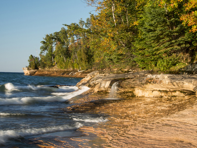 Michigan, Upper Peninsula. Waterfall Along the Edge of Lake Superior Photographic Print by Julie Eggers