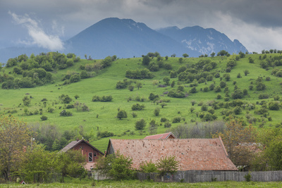 Romania, Transylvania, Bran, House and Bucegi Mountains, Spring Photographic Print by Walter Bibikow