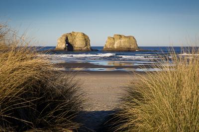 Sunrise over the Twin Rocks, Seastack Near Rockaway, Oregon, USA Photographic Print by Brian Jannsen
