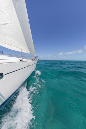 Bahamas, Exuma Island. Sailboat under Sail in Ocean Photo by Don Paulson