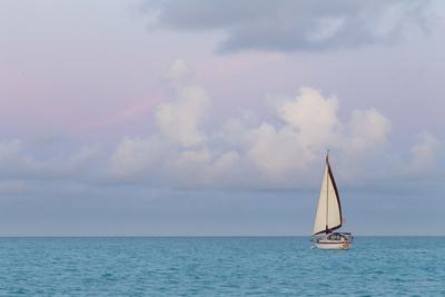 Bahamas, Exuma Island. Sailboat at Sunset Photo by Don Paulson