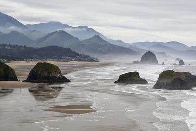 USA, Oregon, Cannon Beach. Fog Rises over Coastline at Low Tide Photo by Jean Carter