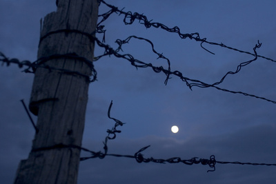 Barbed Wire Fence and the Full Moon in the Oglala National Grassland Photographic Print by Phil Schermeister