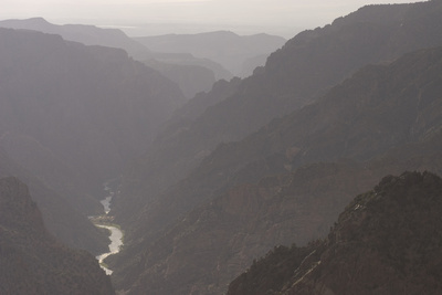 The Gunnison River Winds Through a Canyon from the South Rim of Black Canyon Photographic Print by Phil Schermeister