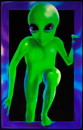 Green Grey alien climbing through a window, blacklight responsive poster wall art