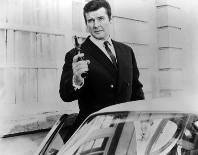 Black and white photograph of actor Roger Moore posing in a scene of The Saint (TV Show)