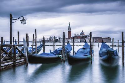 Italy, Veneto, Venice. Gondolas at Dawn with San Giorgio Maggiore Church on the Background. Photographic Print by  ClickAlps