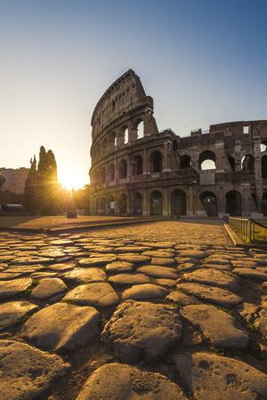 Rome, Lazio, Italy. Colosseum at Summer Sunrise. Photographic Print by Marco Bottigelli
