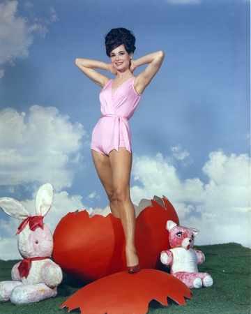 Gila Golan Posed in Pink Dress with Clouds Background Photo by  Movie Star News