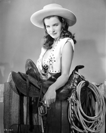 Ella Raines Holding Pistol in Cowgirl Outfit Photo by  Movie Star News
