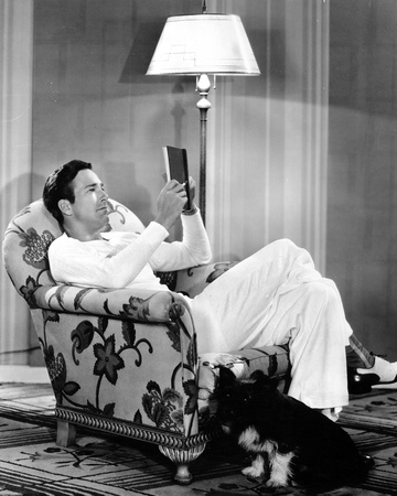 David Manners sitting in White Classic Portrait Photo by  Movie Star News