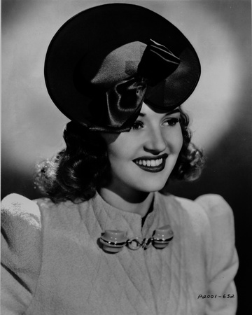 Betty Grable Portrait in Black Hat and White Pointed Sleeve Cotton Dress with Brooch Photo by  Movie Star News