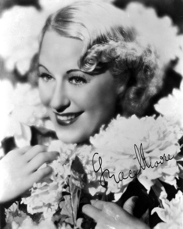 Grace Moore on an Embroidered with Roses and smiling Photo by  Movie Star News