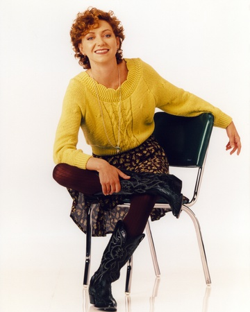 Grace Under Fire Woman Posed in Green Knitted Top Leg Crossed Photo by  Movie Star News