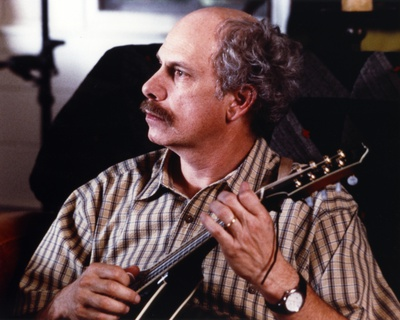 Christopher Guest Playing a Guitar Photo by  Movie Star News