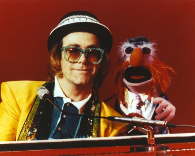 Elton John Playing Piano in Yellow Suit Photo by  Movie Star News