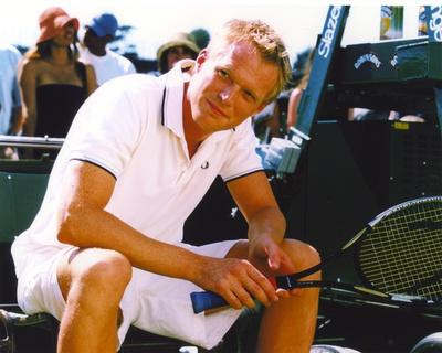 Paul Bettany Seated in White Polo Shirt Photo by  Movie Star News