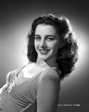 Marjorie Riordan smiling in Classic Portrait Photo by  Movie Star News