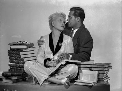 Born Yesterday Man and Woman With Books on Table Foto af  Movie Star News