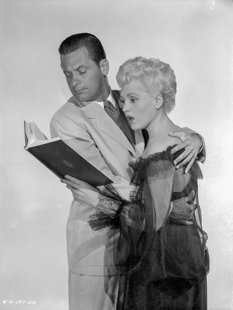 Born Yesterday Man and Woman Reading in White Background Foto af  Movie Star News