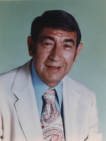 Howard Cosell in White Suit and Printed Necktie Photo by  Movie Star News