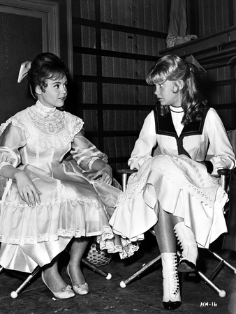 Hayley Mills with a Kid, sitting on a Chair in a Dress Photo by  Movie Star News