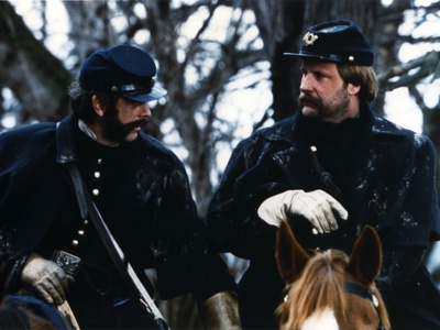 Jeff Daniels Riding Horse in Black Army Uniform Photo by  Movie Star News
