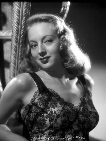 Evelyn Keyes on an Embroidered Top and smiling Photo by  Movie Star News