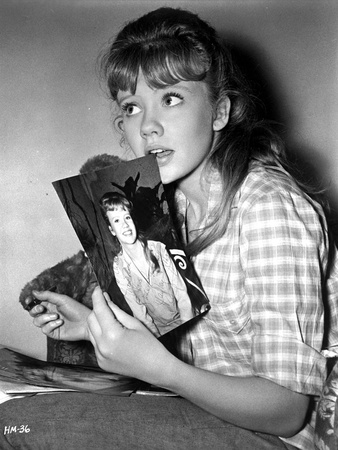 Hayley Mills wearingt a Printed Polo Holding a Photo Photo by  Movie Star News