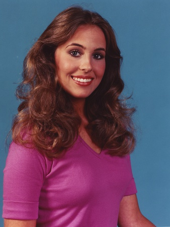 Genie Francis smiling in Blue Background Portrait Photo by  Movie Star News